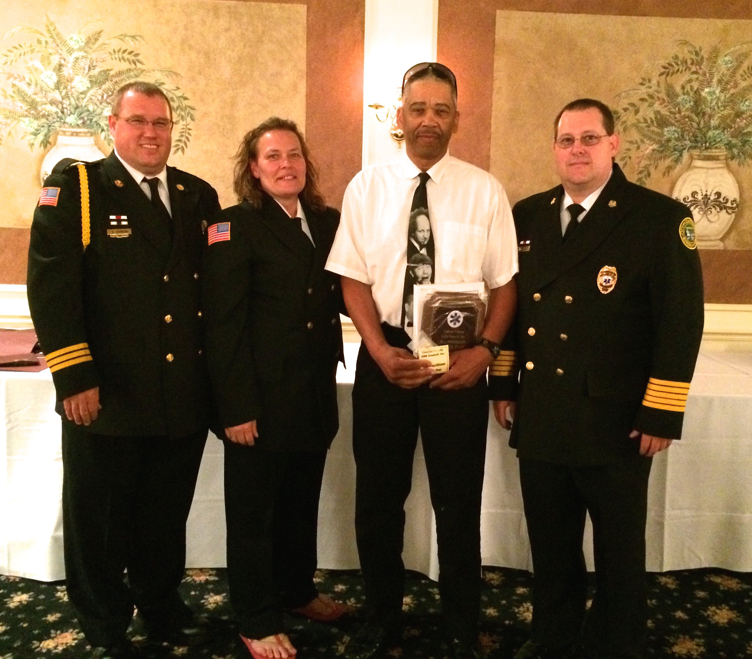 Earl Taylor (third from left), a member of the Washington Hose Co. who also works as a deejay,  poses with EMS officials after receiving the BLS Provider of the Year award.
