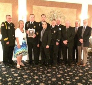 Members of the Southern Chester County Emergency Medical Services – Medic 94 pose with the award they received for distinguished service.