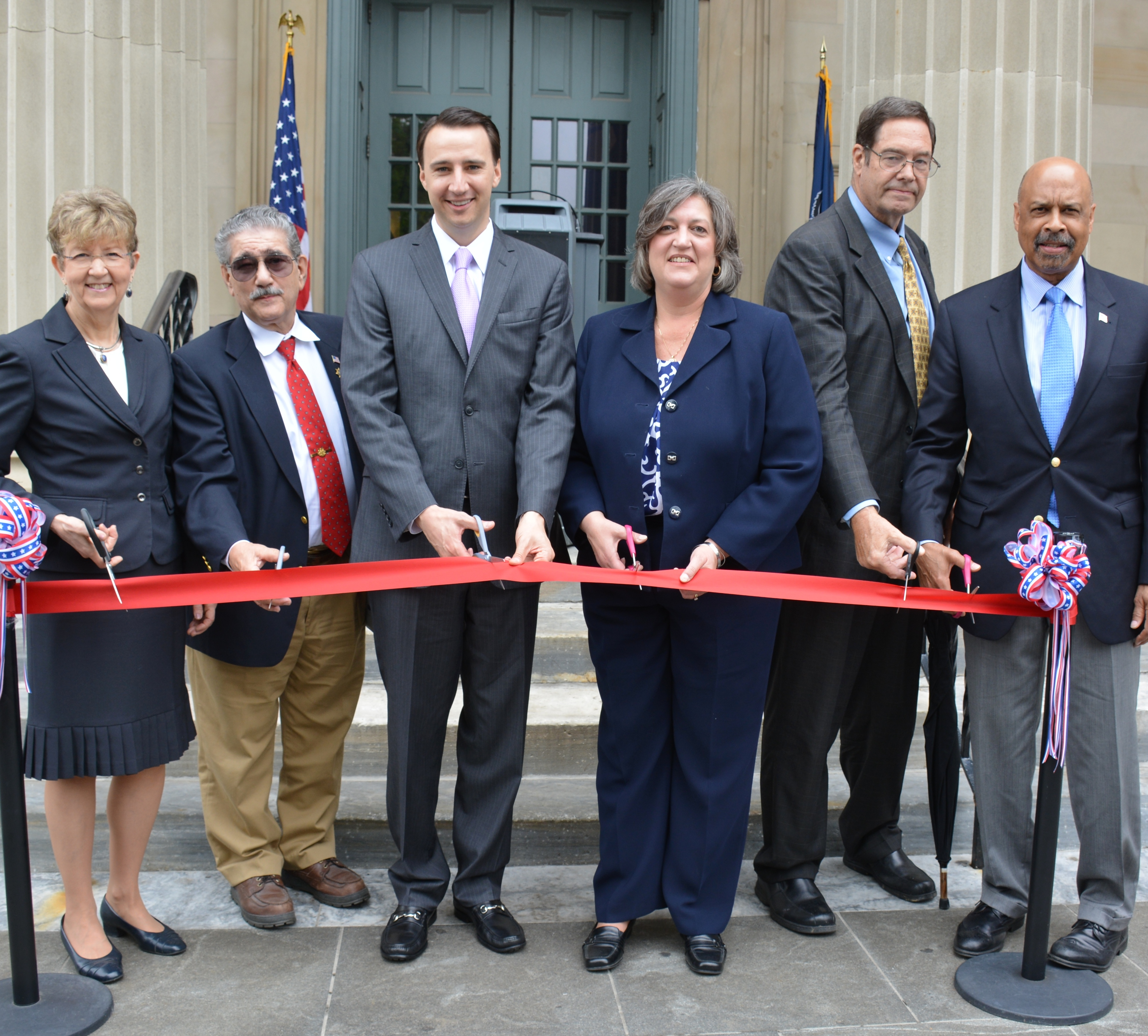 District Judge Gwenn Knapp (from left), Tony Polito from West Chester Men's Service Club, Commissioner Ryan Costello, Commissioner Kathi Cozzone, Chester County Court President Judge James P. MacElree II and Commissioner Terence Farrell assemble for the ribbon-cutting at the historic courthouse.