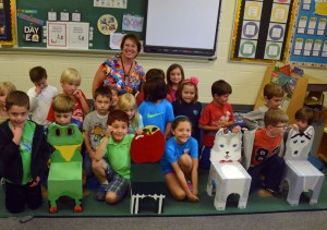 Kindergarten students from Hillendale Elementary School with the new chairs, hand-made by seventh and eighth grade students at Patton Middle School, after the older students delivered them in person earlier this month.