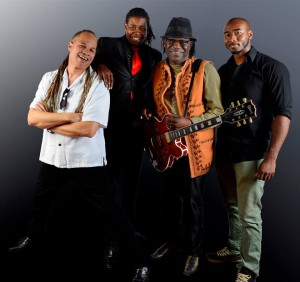 joe louis walker (2nd from right)  and band