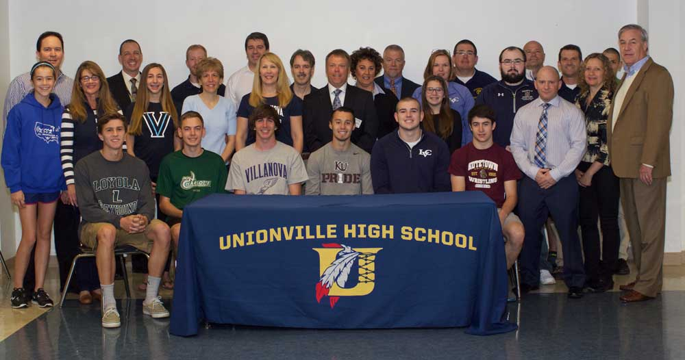 (From Left to Right) Alex Ilgner (Loyola U.(MD)-Rowing), Michael DelVecchio (U of North Carolina Charlotte-XC & Track), Dan Powers (Villanova U.-Track & Field), Brandon Boon (Kutztown U.- Rugby), Patrick Clark, Jr. (Lebanon Valley College-Football), Mitch Camp (Kutztown U.-Wrestling) as they continue their athletic careers in college next year. Joining them in the picture (Left to Right) Faith, Sherri and Ralf Ilgner, James Conley (UHS Principal), Caroline Powers, Matthew Hurray (UHS Track & Field Coach), Janice DelVecchio, Tim and Tricia Powers, Ralph DelVecchio, Jr., Brian Dunbar (UHS Rugby Club Coach), Kelly Boon-Zeidman and Thomas Zeidman, Megan and Maureen Clark, Pat Clark, Sr. (UHS Football Coach), Ian Crampton (UHS Asst. Wrestling Coach), Chris Matz (UHS Wrestling Coach), Todd Szewczyk (UHS Asst. Wrestling Coach), Mark Lacianca (UHS XC and Track & Field Coach), Diane and Dean Camp and Matthew Borger (UHS XC and Track & Field Coach).