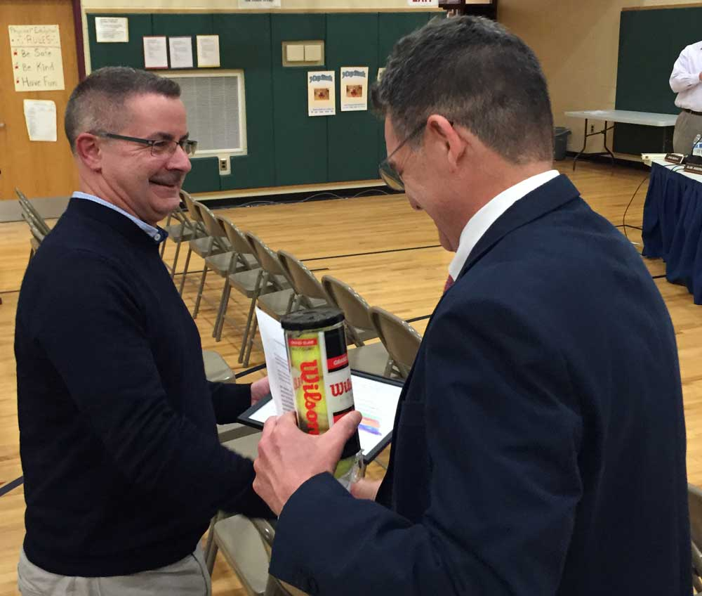 Pocopson Elementary School Principal Clif Beaver offers congratulations to retiring teacher Dennis Nelms during Monday night's Board of Education meeting.