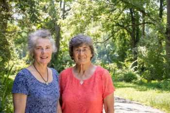 Sisters Patricia Kraus Holt and Kathryn K. McClure on the property they helped preserve as open space.