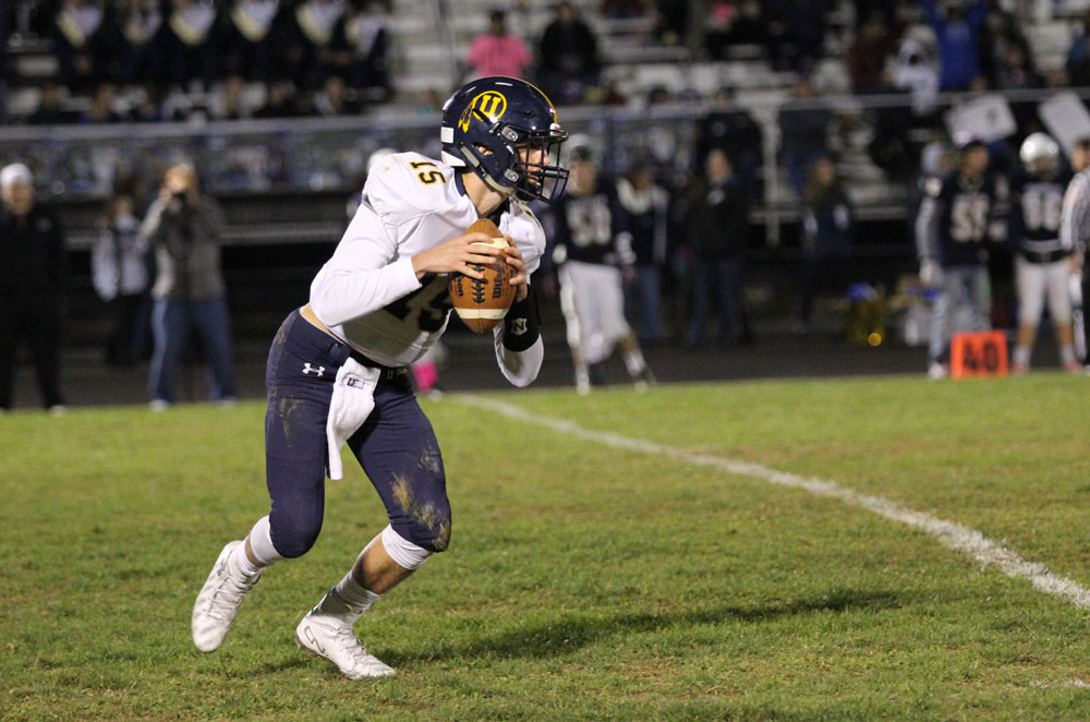 Unionville quarterback Alex Gorgone looks down field just before unleashing a long TD pass to JT Hower. Jim Gill photo.