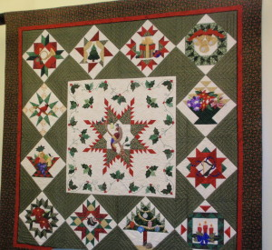 The Christmas-themed quilt was the first in a series of four large quilts plus eight small panels to be completed by the volunteer group.