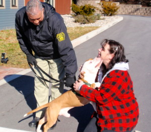 With Chester County SPCA Animal Protective Services Officer Craig Baxter holding his leash, Radar is reunited with Cheryl Shaw, a former SPCA officer, who traveled from West Virginia for the sendoff.