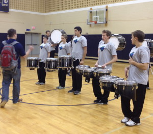 Unionville Drumline Coach Cody Stafford gives his musicians instruction before a recent performance.