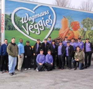 Wegmans employees pose with members of the Chester County Food Bank outside the loading dock.