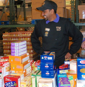 """""""We're all having fun,"""" said Maneesh Chudasama, service area manager at the Downingtown Wegmans, as he sorted pasta."""
