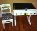 Mrs. Bodine's first-grade class hopes to find a buyer for this desk and chair.