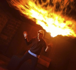 """Henry Roosevelt marvels at the flames created on the set of """"Native Boy."""""""