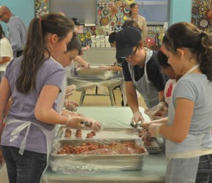 Unionville Elementary School students prepare meatballs from this Saturday's United Way of Southern Chester County/Unionville Chadds Ford School district annual Pasta Dinner. More than a dozen students, along with administrators, teachers, food service workers, gathered Tuesday to make meatballs.