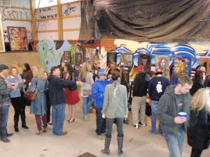 Spectators mingle and survey the art at Bam Margera's skate park, which doubled as a gallery Tuesday night.
