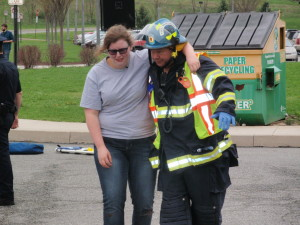 One of the crash survivors gets assistance at the scene.