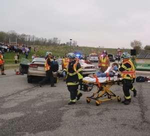 First-responders wheel one of the injured teens to a waiting ambulance.