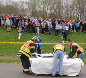 Workers from the Chester County Coroner's Office get ready to place one of the teens pronounced dead at the scene into a body bag.