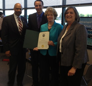 Ruth E. Kranz-Carl holds a certificate she received from Commissioner Terence Farrell (from left), Commissioners' Chairman Ryan Costello, and Commissioner Kathi Cozzone.