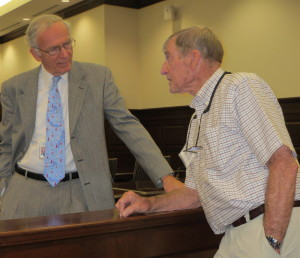 Chester County Court Senior Judge Thomas G. Gavin (left) chats with Ned Shenton, the son of the creator of a 1956 mural that now hangs in Courtroom Two of the Chester County Justice Center.
