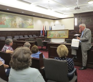 Chester County Court Judge Thomas G. Gavin discusses what little information is known about the 1956 mural   by Edward Shenton. Behind him is the model painting that differs in numerous small ways from the finished product.