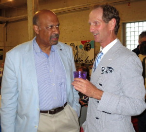 Chester County Commissioner Terence Farrell (left) chats with Don Cochran, president of the Delaware Valley Point-to-Point Association and owner of the warehouse, which served as the venue for the DVA's annual awards party.