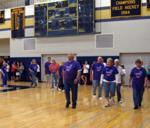 Cancer survivors are applauded by volunteers during the Kennett/Unionville Relay For Life, Saturday.