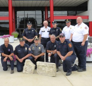 County first-responders pose with the Pentagon 9/11 artifacts