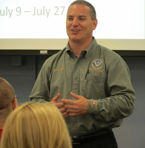 Joe Sciandra, one of the CERT instructors, urges the graduates to continue to be involved in public safety.