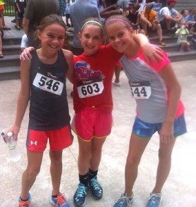Three competitors enjoy a laugh following the 10th annual KAPRB kids race in Anson B. Nixon Park.