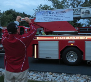 KAU Coach Chris Jarmuz snaps a photo of the banner decorating the Kennett Fire Company truck.