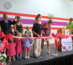 A group of children lined up on Friday to assist with the ribbon-cutting as the Kennett Area YMCA celebrated its grand reopening.