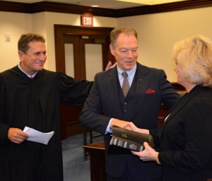 "Chester County Court Judge Anthony A. Sarcione (from left) congratulates Chief Deputy Sheriff George P. March and Sheriff Carolyn ""Bunny"" Welsh, who held the Bible during March's swearing-in."