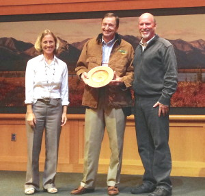 """Bern Sweeney (center) receives the 2013 Lifetime Achievement Forest Champion award. Displaying a handcrafted, wooden bowl with the engraving """"Chesapeake Forest Champion 2013,"""" Sweeney is joined by Al Todd (right), the Alliance for the Chesapeake Bay's executive director, and the U.S. Forest Service's Chesapeake Liaison, Sally Claggett.Photo courtesy of Alliance for the Chesapeake Bay"""
