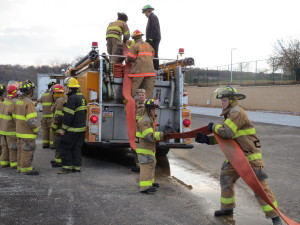 Once the drills are done, everyone's help is needed to put the equipment back in its proper place.