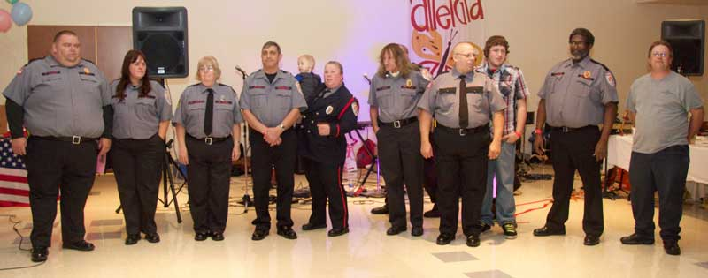 Members of the Modena Fire Company are honored during the ceremony.