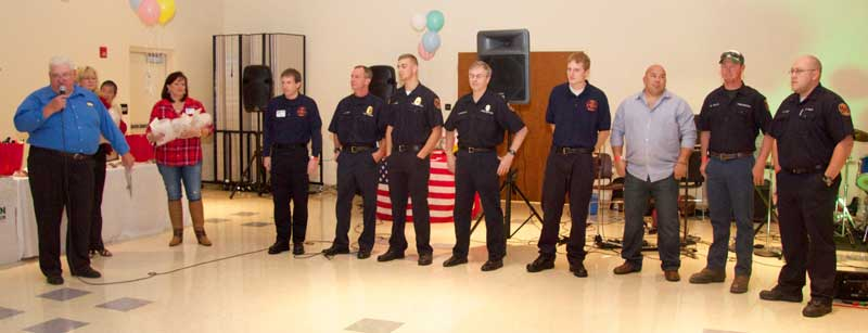 Master of Ceremonies Del Bittle (left) honors the Po-Mar-Lin Fire Company, during the ceremony.