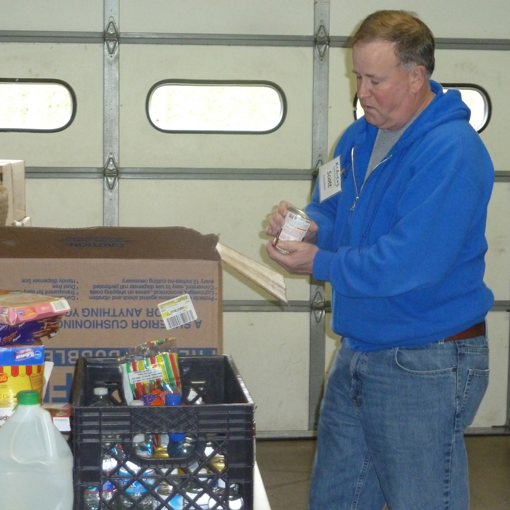 Kennett Food Cupboard volunteer Scott McCoy is just one of over 70 volunteers who donates time to help feed the hungry.  With the holidays approaching, donations are even more critical than usual.