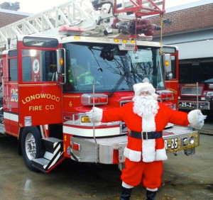 Santa Claus is making pre-Christmas visits throughout the area, courtesy of a Longwood Fire Company truck.