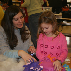 Malina Margolus (left) helps Chadds Ford Elementary Kindergartener Ava Robbins (right) craft a no-sew blanket to be donated to children in need.