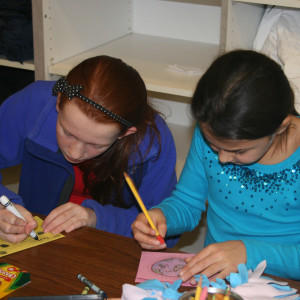 Unionville Elementary students Taryn Blecher (left) and Jessica Hall (right) decorate a card and write words of encouragement for sick children at A.I. duPont Hospital for Children.