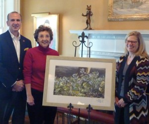 Craig Kandravi (from left), club steward of Radnor Hunt; event co-chair Renny Wood of Chadds Ford; and decorations chair Jane Taylor of Berwyn show off the signed Frolic Weymouth print that will be auctioned at the gala.