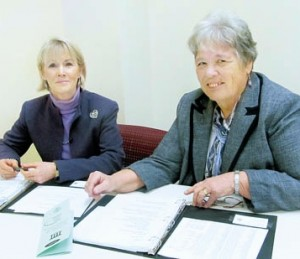 Diane P. Mulhearn (left), the Volunteer Guardianship Program coordinator, and Nancy Breuer, Assistant Orphans' Court Administrator, review files for the program.
