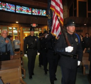Members of the West Goshen Township Police Department Honor Guard file into Central Presbyterian Church in Downingtown.