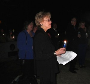 Peggy Gusz, executive director of the Crime Victims' Center of Chester County, listens to remarks at the Victims' Memorial in Downingtown's Kardon Park.