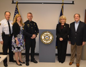 "Chester County Chief Deputy George P. March (from left), Patty Hansen, Cpl. Kurt Hansen, Sheriff Carolyn ""Bunny"" Welsh, and State Sen. Andy Dinniman appear at the ceremony honored Hansen."