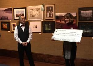 Time Light Art Group gives $500 check to CCAA