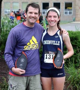 Unionville's Kacie Breeding and coach Mark Lacianca (file photo, courtesy milesplit.com) head into this week's District One track meet at Coatesville with high hopes after winning the Ches-Mont League meet last week.
