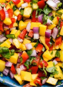 Grilled fruits combined with vegetables add smokiness and sweetness to summer salsas.