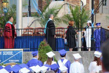 Kennett Consolidate School District Board of Education President Kendra LaCosta presents diplomas to graduates of Kennett High School, Friday night.