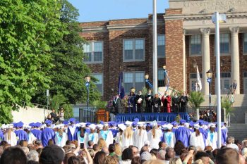 In keeping with long tradition, Kennet High graduates entered the ceremony down the school's front steps, as everyone enjoyed the perfect weather, Friday evening.